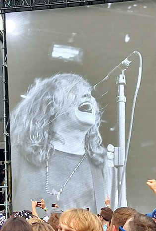Laura Jane Grace from the band Against Me! sings at Riot Fest. The picture is of the large screens so Laura can be seen from far away.